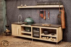 Concrete-Jungle buitenkeuken, massief eiken met natuurstenen bladen en een Big Green Egg | Oakwood outdoor kitchen