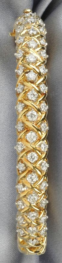 18kt Gold and Diamond Bracelet, Tiffany & Co., designed as a hinged bangle set with full-cut diamond melee, approx. total wt. 2.10 cts., 20.9 dwt, interior cir. 6 1/2 in., signed.