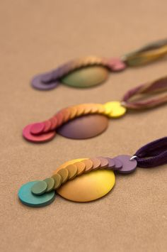 Polymer clay pendants by Carina's Photos and Polymer Clay, via Flickr