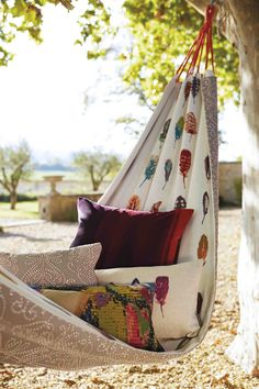 Put your feet up this summer and relax in a stylish hammock! We love the one we created using Harlequin's Amazilia fabrics.