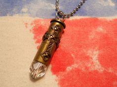 """Pray for our Troops""necklace. It's a .38 caliber brass shell, with a crystal attached to the bottom and  an ornate brass cross attached to the front. The pendant is on a  28"" long dog chain. It is made by a lady in Kingsville, Texas named Teresa Yates. You can find her on etsy.com...pray for our troops everyday. If your American, they are sitting on that fence.....for you."