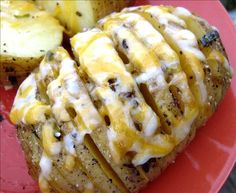 Sliced Baked Potatoes from Food.com:   								This is a very easy way to give the bland potato a lot of new flavour. The light coating of butter and cheese given the potatoes a crisp outside. This recipe can also be microwaved. See Microwave Sliced Baked Potatoes.
