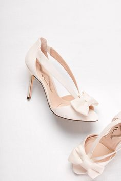 A traditional wedding heel with a modern twist! Shop these strappy bow peep toe pumps at David's Bridal