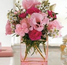 Make Fresh Flower Arrangements: The beautiful colors and delicious scent of a fresh flower arrangement add an alluring element to a home. Use flowers fresh from your garden or pick up a dozen at your local florist. Various kinds of containers can be used for the arrangement such as a clear vase with colored stones added in the bottom, a decorative coffee can, baskets or a pretty pitcher.  Things You'll Need:  12 to 24 fresh flowers. Pick the container you wish to use for your arrangement. Be…