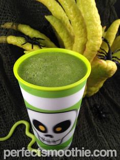 Green Slime Smoothie Recipe - This Halloween-inspired smoothie is a great way to serve a healthy beverage at a fall party or to your kids during the fall season. Trick or treat! No one will know that they are drinking spinach because the green apple flavor dominates the taste. This treat in disguise will trick them into healthy eating.