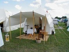 """One of the more versatile tent designs, in my opinion, and a view of some of the """"internal"""" stuff. That lamp is one of the things I want to do; get a cheap candle lantern and a garden rod, then frost the glass and put an LED tea candle inside!"""