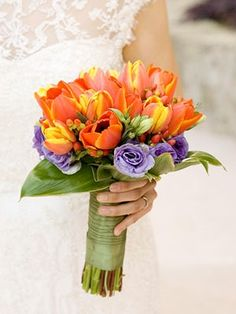Simple bouquet: orange tulips surrounded by purple lisianthus