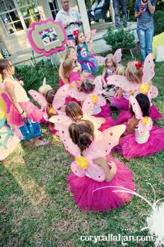 Fairy birthday party complete with wands & fairy dust. (wings, tanks & tu tu's as favors). So cute.