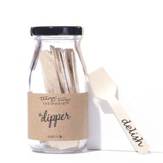 """Set of 20 unique """"dipper"""" spoons made out of disposable birch, and packaged in an adorable glass milk bottle. Perfect for serving cheese balls or any single-serving appetizer."""