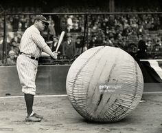 Babe Ruth is shown about to swing at the world's largest baseball.