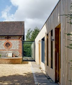 Adam Knibb Architects extends Hampshire barn conversion with timber-clad box