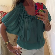 Fifteen-Twenty Silk Chiffon Blouse Fifteen-Twenty Silk Chiffon Blouse. Bunching at the neckline with dangling shreds of fabric. Elastic waist. Color is light teal. Very sheer but you can always wear a cami underneath. I have never worn this blouse. Dry Clean Only. Fifteen-Twenty Tops Blouses