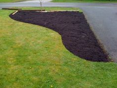 how to curve a front landscape | ... up from in front of the old bed running along the front of the house