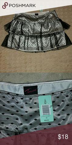 NWT Polka-dot Skirt Satin like white skirt with black Polka-dot tulle overlay. Side zip closure. Torrid Skirts Mini