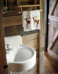 rustic powder room with corner sink and wood paneling 0812_powder00_rect540