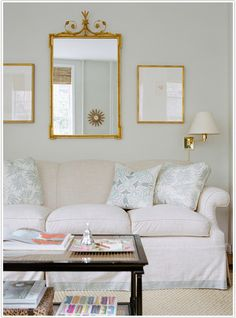 Ashley Whittaker Design - lovely soft blue and bright gold in living room, grounded by black table