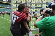LONDON, ENGLAND - SEPTEMBER 01: Chris Ashton receives a friendly kiss from team mate Schalk Brits after receiving the Aviva Man of the match during the Aviva Premiership match between Saracens and London Irish at Twickenham Stadium on September 1, 2012 in London, England. (Photo by David Rogers/Getty Images) 2012 Getty Images
