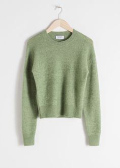 Front image of Stories fuzzy sweater in green