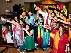 Colorful indian bridal party shot | Image courtesy of Tomas Ramos Photography + Film Productions. Discover more Indian Bridal Party inspiration at www.shaadibelles.com #weddings #southasian #shaadibelles #bridesmaids #groomsmens