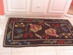 Pomegranate rug, design by Chris Sherman-Searsport Rug Hooking