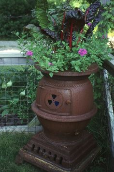 Container Gardening in an old pot-bellied stove