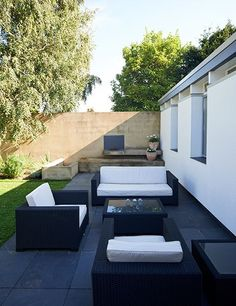 The house sits on a large, meticulously maintained parcel that offers a private rear garden—a rare feature for the area.