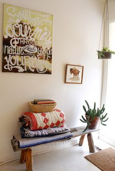 DIY Thrifted Artwork Typography with a rustic bench and blankets