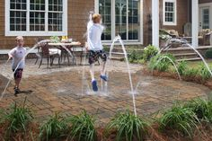 Neat idea for a water feature for the kids - just permeable pavers and spouts.