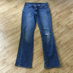 Lucky mid rise flare distressed dungaree jeans Preloved. Size 4/27. The hole in the knees came after purchase. Small hole in the back of the leg, too. See the last picture for that. Priced according to wear. Super cute distressed jeans! Lucky Brand Jeans
