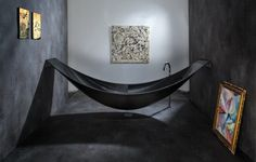This is the carbon fiber 'Vessel' bathtub designed and built by Splinter Works. It mounts between two walls, drains through a hole in the floor, and probably costs more than a car. Obviously, it's going on the Christmas list.