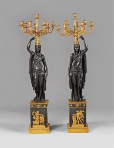Ca. 1800 - 1810, possibly Feuchère workshop.A large pair of Parisian ormolu candelabra formed as Nubian figures.
