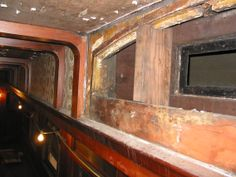 This is what it looked like once we removed one of the wood panels that are covering the clearstory windows. When the car was outfitted with air conditioning in 1921, they ran the ductwork along the outside of the clearstory windows which made them virtually useless and covered them up. Frames are intact but panes removed. Wood Brace placed in center for additional strength.