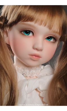 Dollmore Lusion Doll Whispering Lilia - this charming girl is actually 80cms in height. She's more like a porcelain doll aesthetic-wise, as she resembles a child rather than a adult model.