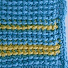 Tunisian reverse stitch swatch worked in bulky yarn with sc border.
