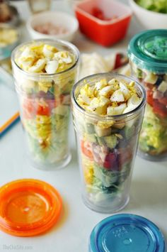 to go tumblers layered with salad