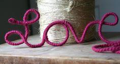 "wire reinforced clothesline (available at home improvement stores), yarn & wire clippers. Clip off a length of clothesline and shape into the word ""LOVE"". Tie yarn onto beginning of word and wrap around wire."