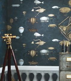 Fornasetti II Collection  'Macchine Volanti' by Cole & Son features wondrous flying machines hanging amongst the clouds evoking the romantic New World of scientific exploration  this striking design is supplied in a set of 2 rolls, each set can cover 148 sq feet of wall (e.g. a wall up to 9 feet high and 13 feet wide) addition sets can be purchased for larger areas.  Available at Finest Wallpaper . com Designer Wallpaper Online Store for USA & Canada