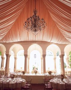 Love the dramatic ceiling and  the chandelier is breath taking... Gorgeous!