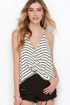 The Dapperly Draped Black and Cream Striped Halter Top will have you looking and feeling charming! A soft and striped jersey knit drapes from spaghetti strap halter ties into a low-dipping cowl neckline that twists at front above a cropped hem. Bodice lays in a loose, comfy fashion, for effortless day-to-night wear. Front of bodice is lined. 95% Rayon, 5% Spandex. Hand Wash Cold. Made With Love in the U.S.A.