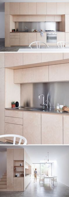 Kitchen Ideas - Polished concrete floors together with white walls, simple furniture, hardware-free light plywood kitchen cabinetry and a stainless steel backsplash and countertop, make this kitchen with dining area contemporary and minimal in its design.