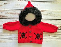 A personal favourite from my Etsy shop https://www.etsy.com/uk/listing/553167404/baby-gothemopunk-hand-knitted-skull