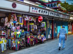 """Out of Nakamise Dori/Street's 88 shops, """"Okadaya"""" (http://www2.odn.ne.jp/okadaya/) at the left side, just before you reach the corner of Denpoin Dori/Str. is the one opening first each and every day, winter or summer. They specialize in umbrellas (always a handy object in Japan -not just Asakusa) but you can also get the usual assortment of souvenirs as well.  #Asakusa,  #Nakamise, #Okadaya Taken on June 11, 2014. © Grigoris A. Miliaresis"""