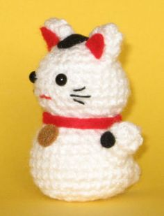 """Here's an amigurumi pattern for a little Japanese Beckoning Cat, or Maneki Neko. These little cats welcome customers and are thought to bring good luck. """"Onni"""" is a Finnish word/name meaning """"luck.…"""