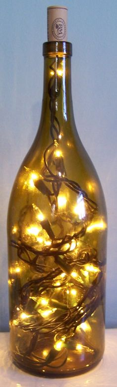 DIY Wine Bottle Lamps.  Literally JUST talked about this at work. How I'm not an alcoholic, just collecting. :)  I'd like to put them above my cabinets in the kitchen.