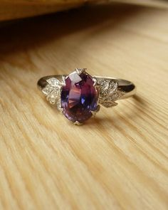 The most gorgeous engagement ring I've ever seen. I feel so lucky to call it mine! Kate Szabone did an incredible job making it absolutely perfect. #purple #sapphire #engagementring All ethically sourced too!