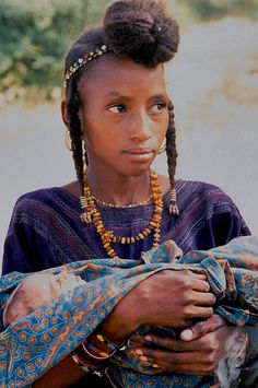 Africa   Wodaabe girl holding a baby. Niger   ©Marti Brown