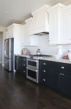 hole-in-one parade home | st. george, utah | by alice lane home collection | kitchen, white cabinets, navy cabinets