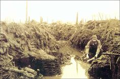 German soldier in a waterfilled trench in the vicinity of Ypres, Flanders (Belgium). This picture was made in November 1915.