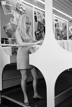 "isabelcostasixties: "" Olinka Berova. London, 24 July 1967- Olinka Berova, Czechoslovakian actress, long hair loose, in short sleeveless dress, looking for records on a display, in a record store """