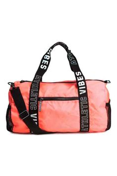 Cylindrical sports bag in woven fabric with two handles, a detachable, adjustable shoulder strap, and a zip at top. Pocket along one long side Black Handbags, Leather Handbags, Tote Handbags, Luxury Handbags, Adidas Duffle Bag, Duffle Bags, Bags For Teens, Computer Backpack, Everyday Bag